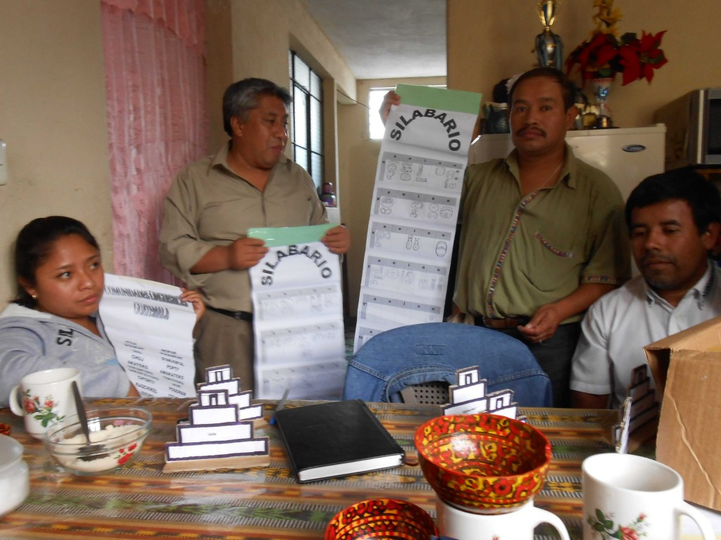 The Coban team has developed its own teaching materials, including this unique presentation of the hieroglyphic syllabary (from left to right: Yudy Mo', Mario Caal, Augusto Tul Rax, and Leonel Pacay Rax).