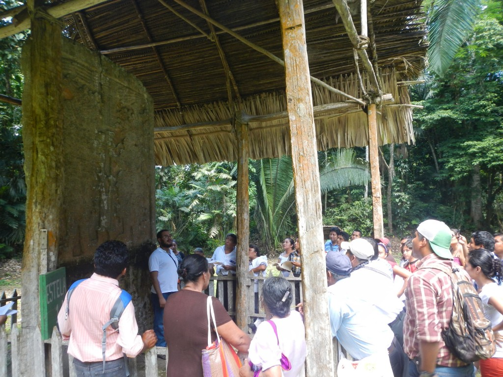 An explanation of Stela 1 during the visit to Ixkun.