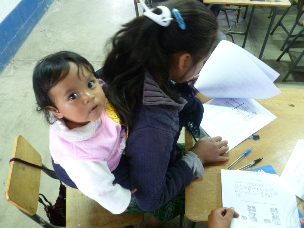 Adults and children came together to learn Maya Paytz'ib (ancient Maya writing in Q'anjob'al).