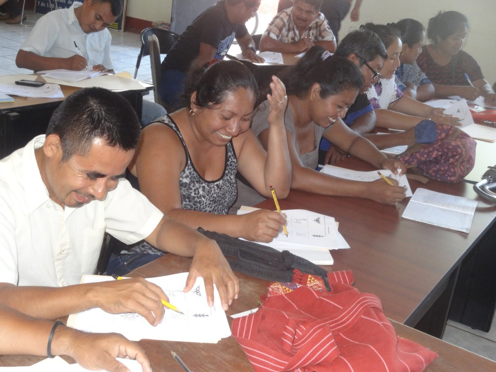 Group of teachers doing exercises in the Tz'iib reading and writing System.