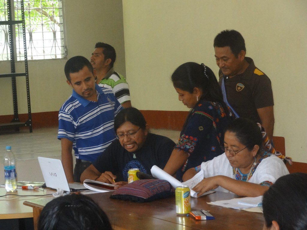 Hector Xol reviewing exercises performed by teachers.
