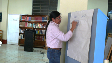 "Hector writing the words kay and ch'uu, whicn is ""fish"" in Yucateco and Tz'utujiil."