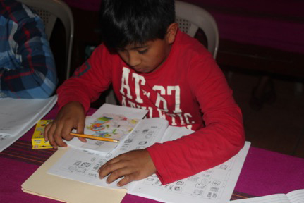 Writing his name with the help of the syllabary